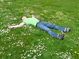 guy_relaxing_on_grass